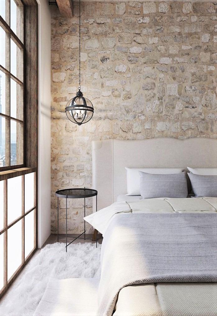 zona notte con muro effetto pietra bianca