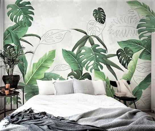 grande letto bianco con cuscini e coperta grigia