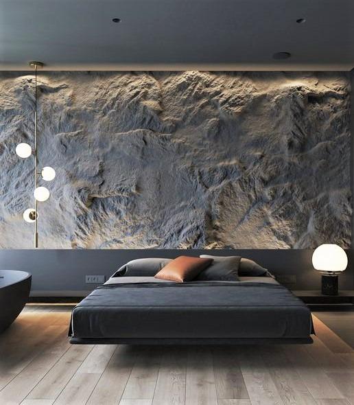 parete effetto caverna con letto grigio