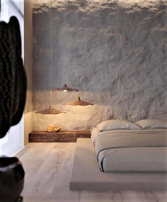 letto basso bianco con luci sospese